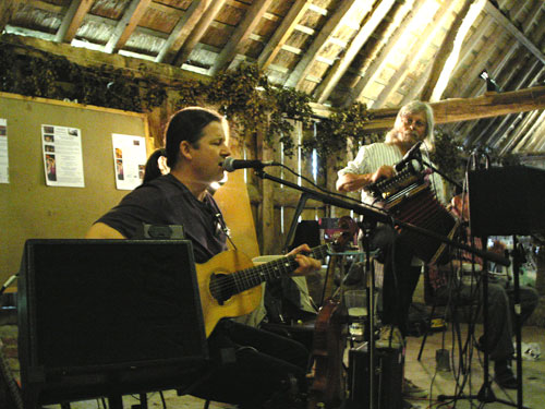 Yves Langlois on fiddle, and Chris Taylor on guitar, bouzouki, harmonica and accordion